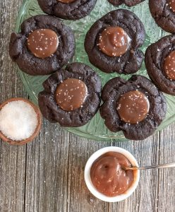 salted caramel chocolate cookies on a cake plate