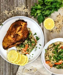 BBQ lemon chicken on a plate with rice pilaf