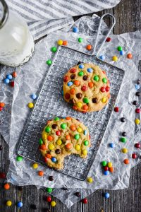 loaded M&M Chocolate Chip Cookies on a rack