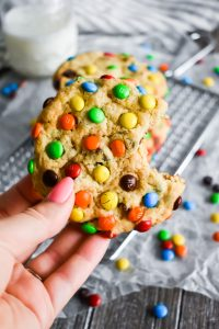 loaded M&M Chocolate Chip Cookies with a bite