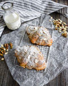 Pistachio Almond Croissants on a rack