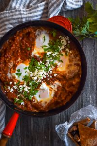 Shakshuka with Israeli couscous in a red skillet