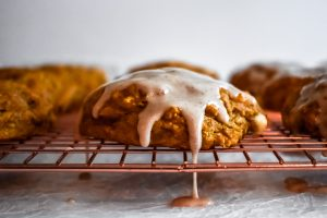 Pumpkin Scones with Cinnamon Glaze with glaze drip