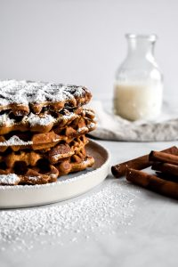 Gingerbread Waffles on a plate with milk in the background