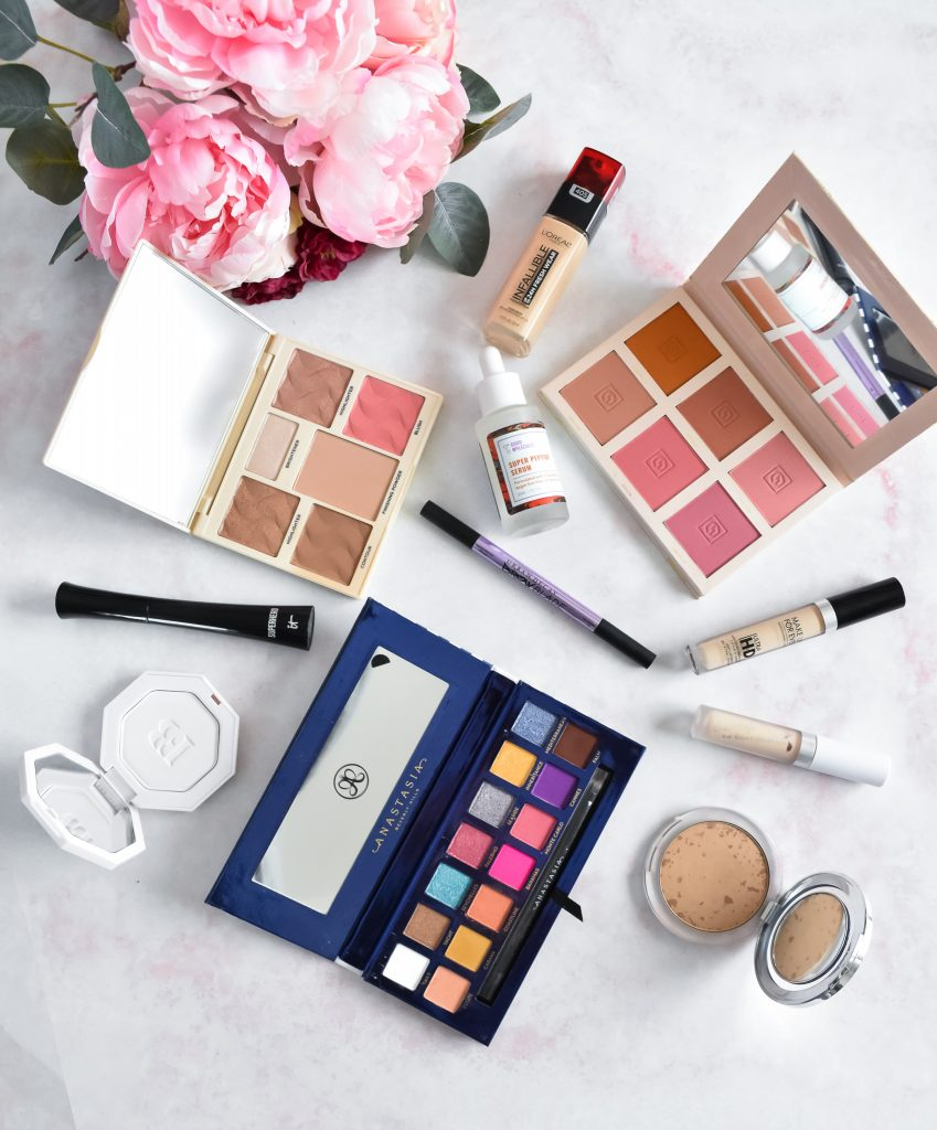 Makeup Favorites -- March 2019 round up on pink background