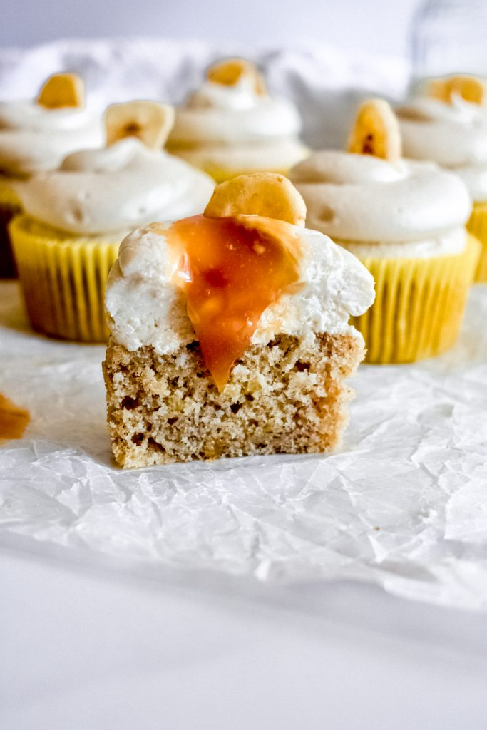 roasted banana cupcakes with salted caramel frosting on parchment