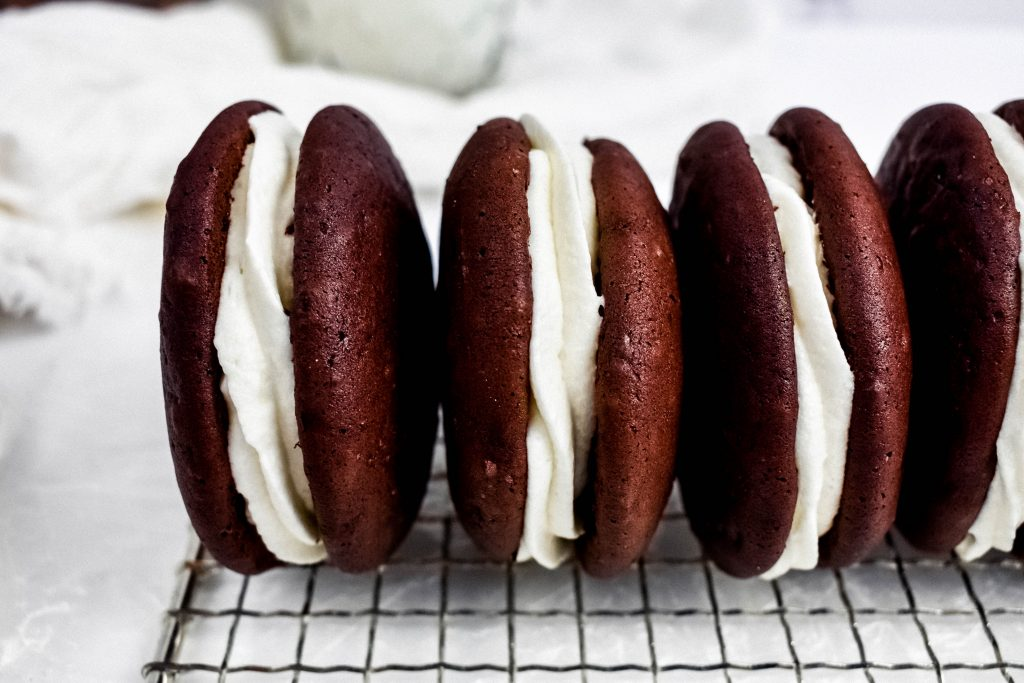 Chocolate Guinness Whoopie pies  side by side on a rack
