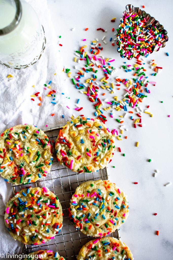 funfetti cookies on a rack with sprinkles
