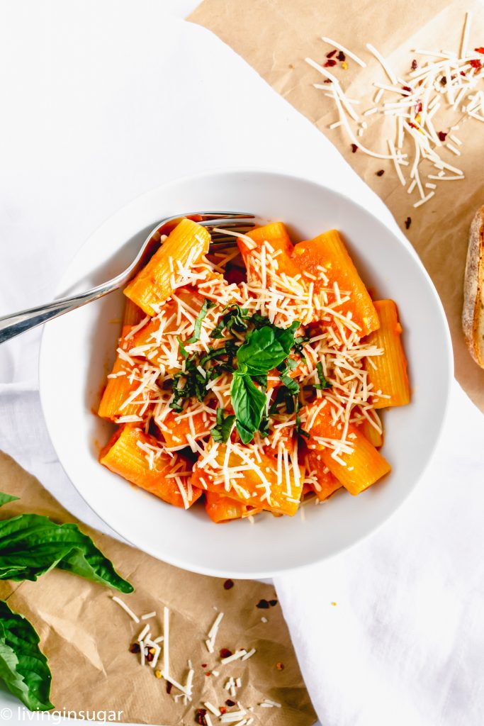 Rigatoni with easy vodka sauce in a bowl with a fork