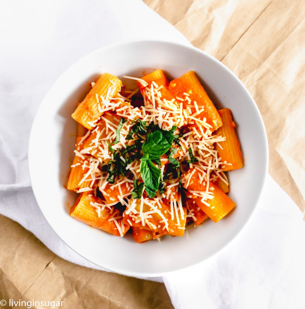 Rigatoni with easy vodka sauce in a bowl on a towel
