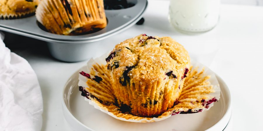 Starbucks Style Blueberry muffins unwrapped sitting on a plate