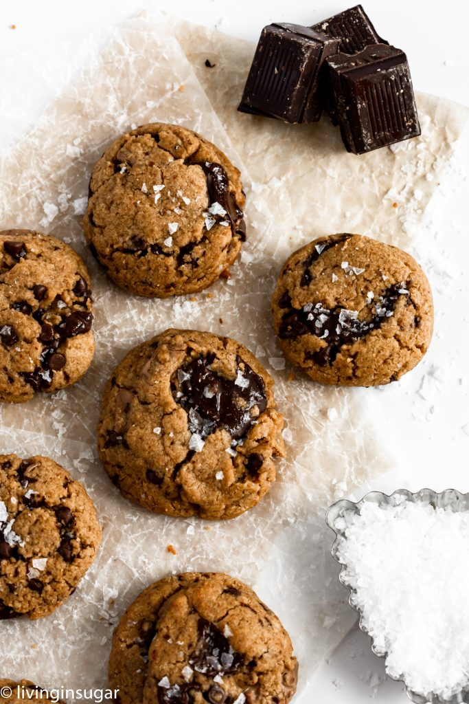 peanut butter chocolate chunk cookies on parchment paper