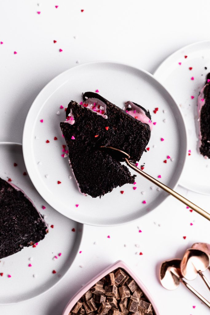 Dark Chocolate Zucchini Cake sliced on a plate
